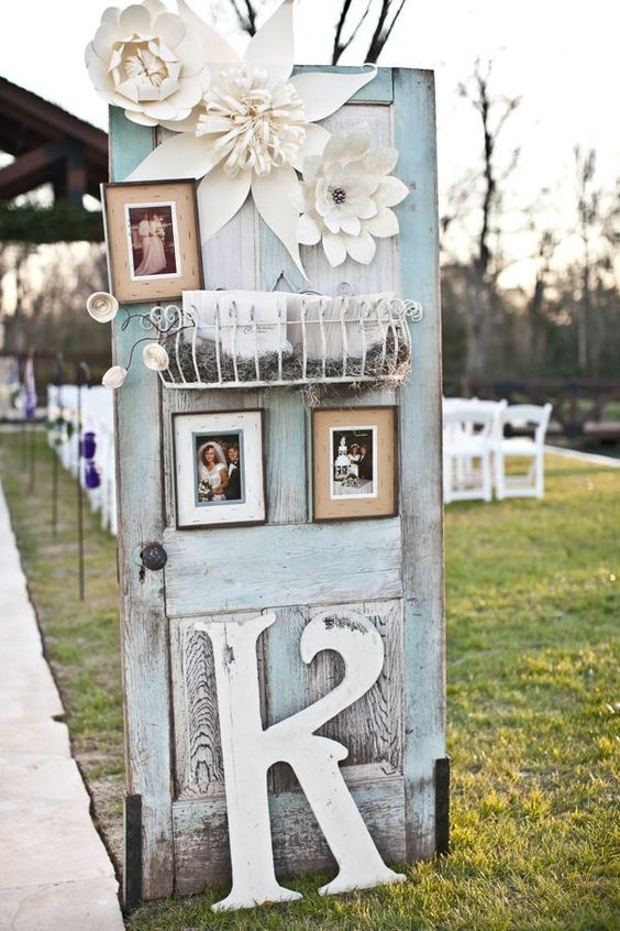 patina colored door with photos and monograms for wedding decor