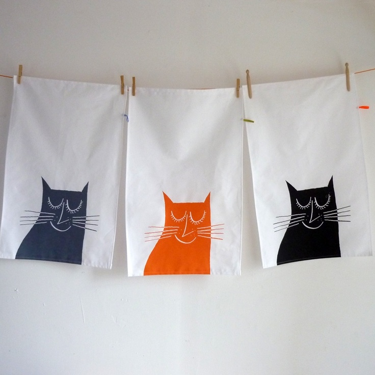 Mr. PS.  Awesome #screenprint #prints + #home accessories and #tees: Image of Happy Cat tea #towel $21  shipped #kitchen #gifts #cat >>  Single image, single color, weighted at bottom on white background. Shown here printed in different colors- a great way to keep a simple design interesting as a set.