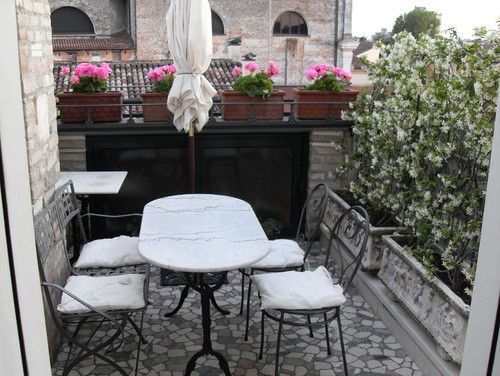 Italian patio, simple black and white dining