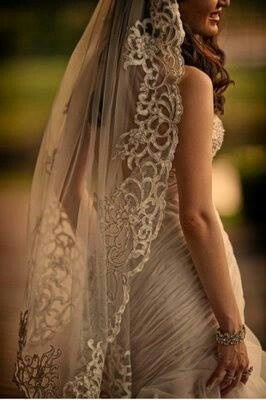 Beautiful gold wedding dress and intricate veil