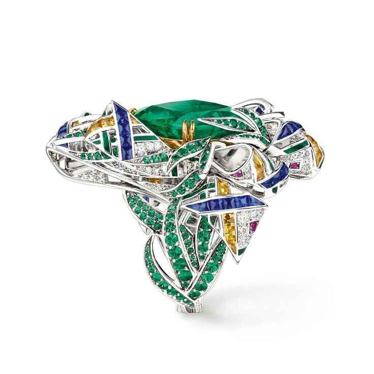 Chaumet est une fête high jewellery ring, with a large central emerald, sapphires, yellow sapphires rubies and diamonds. http://www.thejewelleryeditor.com/jewellery/article/chaumet-est-une-fete-high-jewellery-review/ #jewelry
