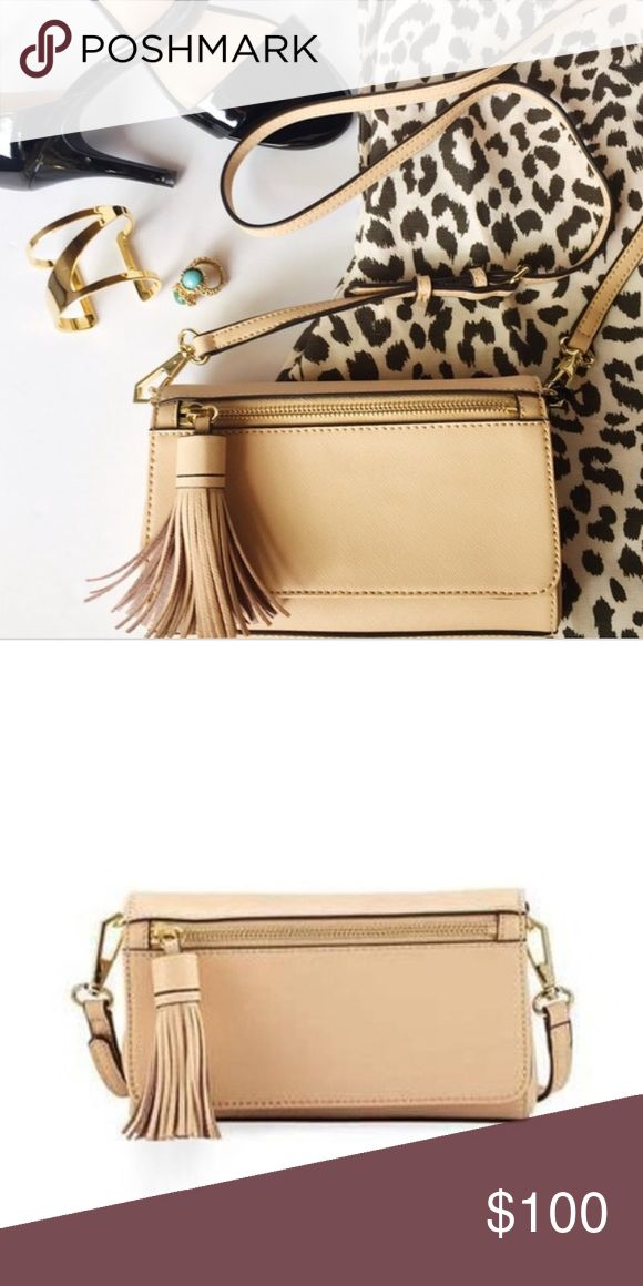 "Rebecca minkoff crossbody bag Cyber Monday sale ‼️Leathered cross body bag with Detachable adjustable shoulder strap. Tassel trimmed zipper front pocket, slit back pocket , designer plaque, silver tone hardware details Snap fastening front flap.       16 card slots Measurements: 8""L 6""H 2"" D Rebecca Minkoff Bags Crossbody Bags"