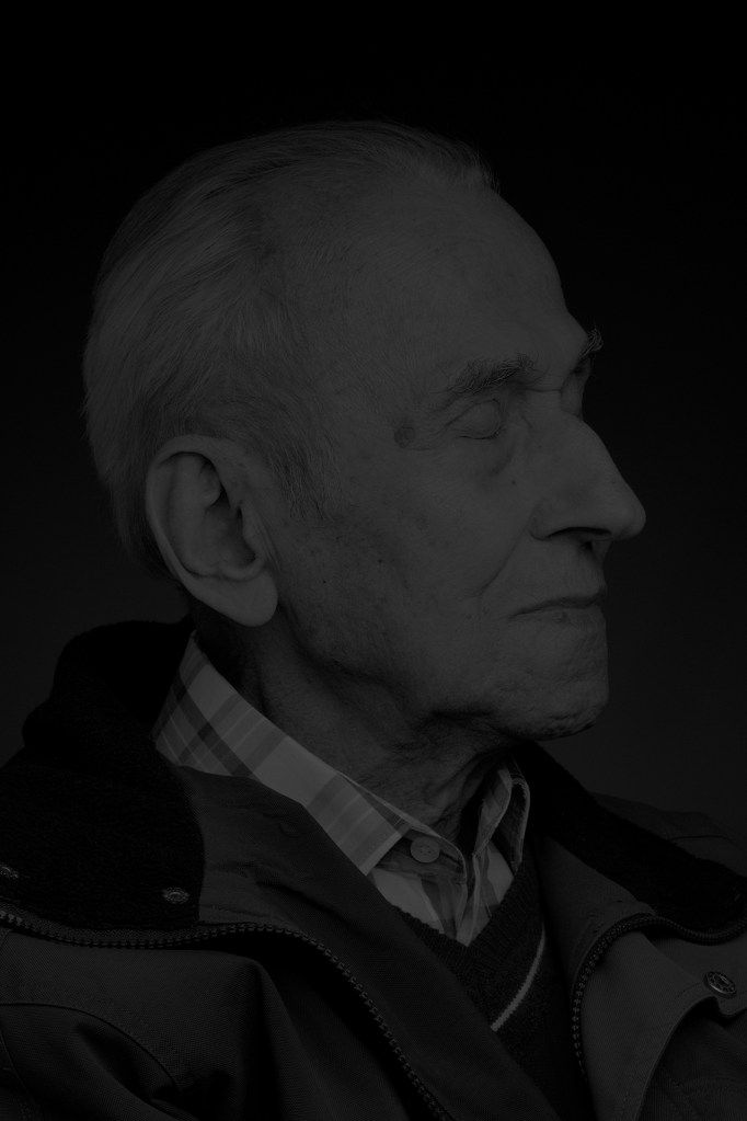 I started the series at the end of 2012. This is nearly seventy years after the end of World War II (and the liberation of last Nazi concentration camps). Before starting taking portraits of ex-inmates the question was: What remnants of such a terrifying experience can be seen on the faces of old men and women after so many decades? How can you show the remains of memories or memories themselves? I deliberately decided not to use any kind of marks or objects directly associated with…