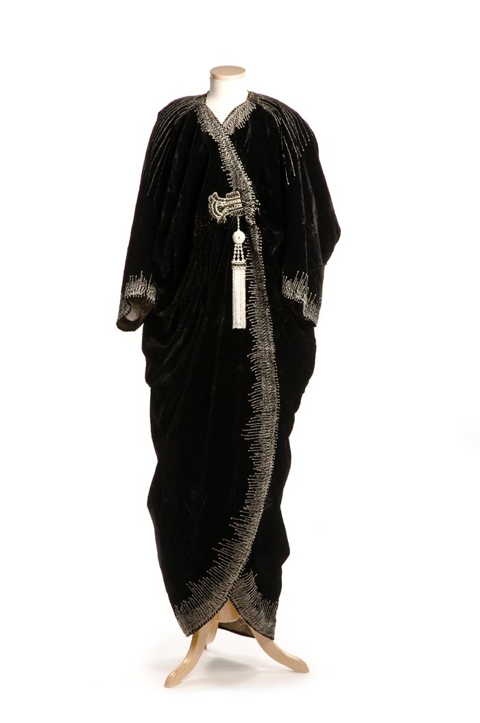 Black velvet evening coat with beaded ornamentation, designed by the couture House of Worth in Paris, c. 1912.