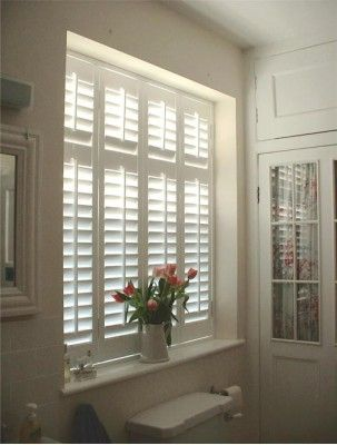Inside mount shutters example in bathroom window