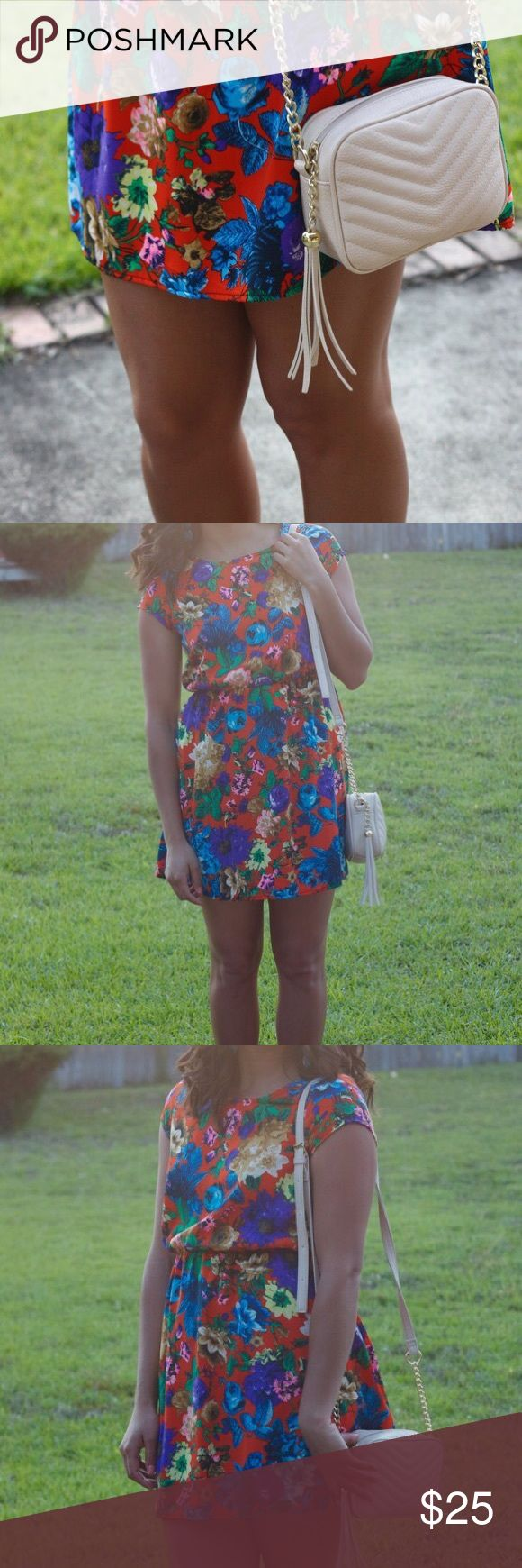 boutique floral dress A perfect party dress in the best floral print! This dress has a comfy elastic fit & flare and a tasteful cut-out back. Originally purchased at Wish boutique in Memphis. Fits like an XS-S, in perfect condition! Dresses