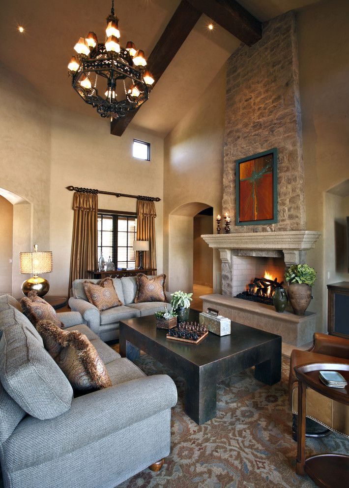 Faux stone fireplace living room traditional with arch doorway archway beige wall brown area