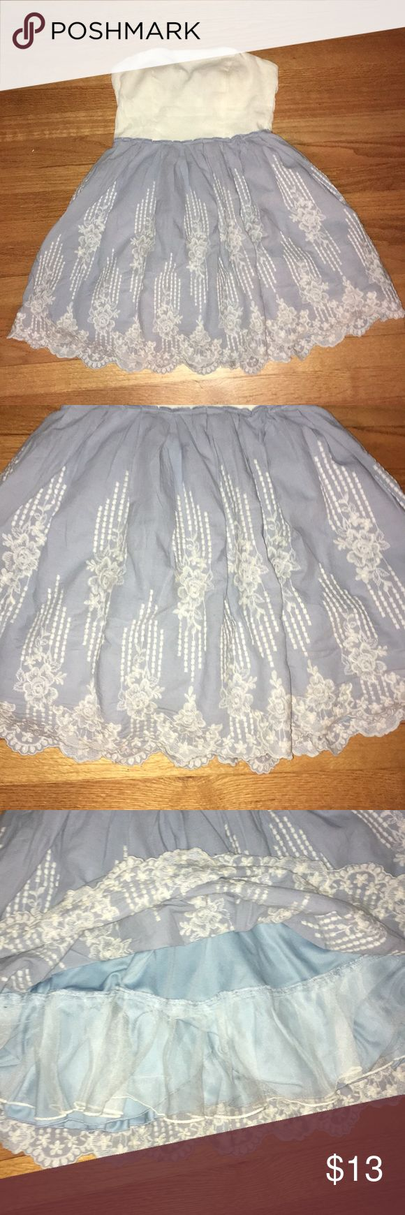 Blue and White Sweetheart Cut Tulle dress Beautiful blue and white mini tulle dress- sweetheart cut perfect for a casual night out. Gently worn. No belt included Dresses Mini