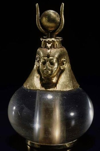 Hathor-headed crystall ball amulet.  Nubian, Napatan Period, reign of Piankhy (Piye), 743–712 BCE. From el-Kurru, Ku 55 (unknown queen of King Piankhy), excavated by the Harvard University–Boston Museum of Fine Arts in 1919.