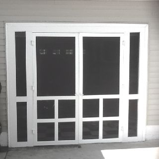 Homemade screen doors for garage door opening. Love this idea. Plus a matching front screen door.