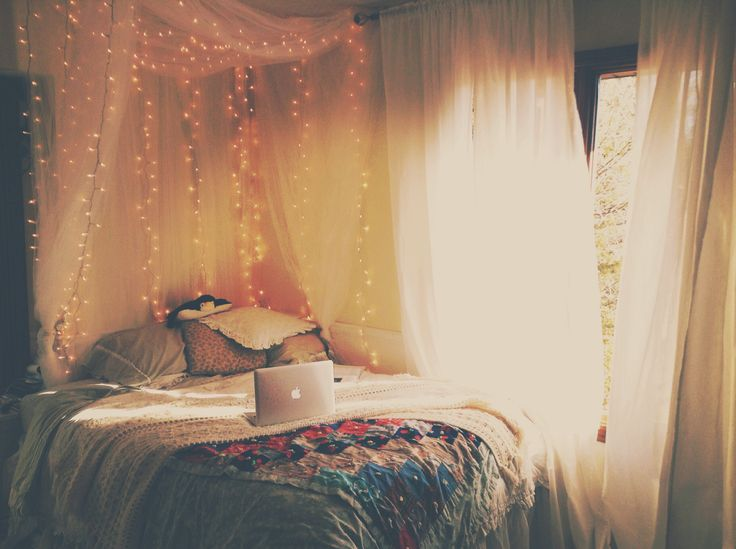Cozy Bedroom. Tulle canopy, with white lights.