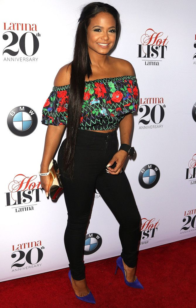 Christina Milian in a floral ruffle Kenzo x H&M top and skinny black pants