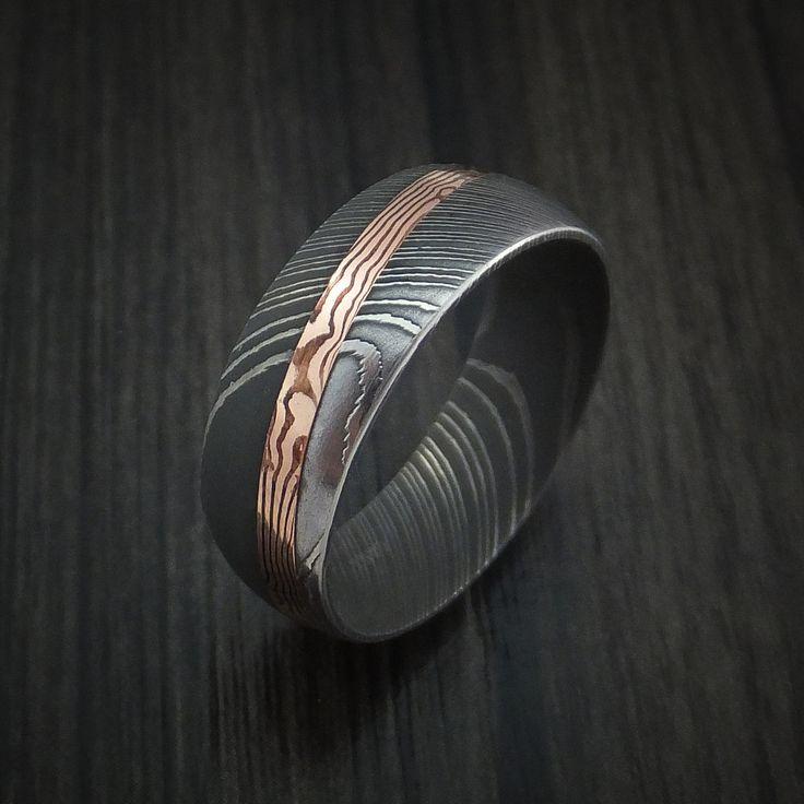 Damascus steel ring with diagonal rose gold mokume inlay