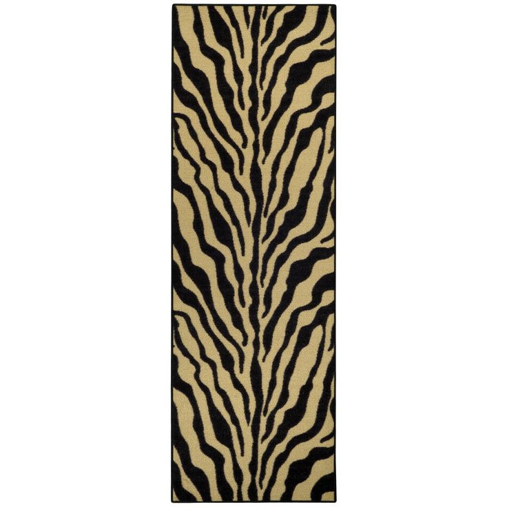 This colorfully printed runner rug features a trendy black, ivory and tan tiger print or a modern, versatile touch to any room. Designed to be stain resistant, this rug features a non-skid rubber backing, alleviating the need for a rug pad.