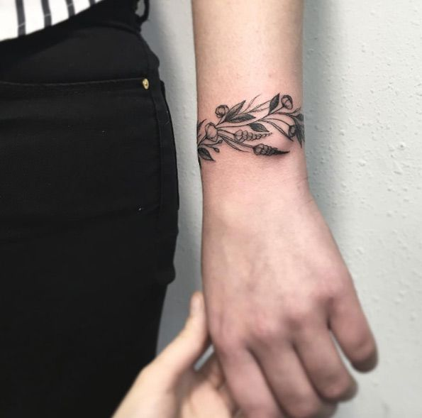 Botanical bracelet tattoo by Vlada Shevchenko