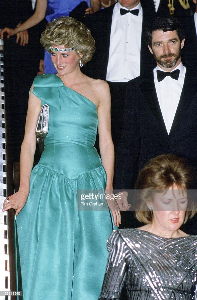 October 01, 1985: Princess Diana In At A Gala Dinner Dance In Melbourne, Australia Wearing An Emerald Necklace As A Headband With A Green Satin Evening Dress Designed By Fashion Designers David And Elizabeth Emanuel. Princess Diana wore a very similar dress to this (with a headband) on her 1983 visit to Australia, but right sized shoulder strap there..