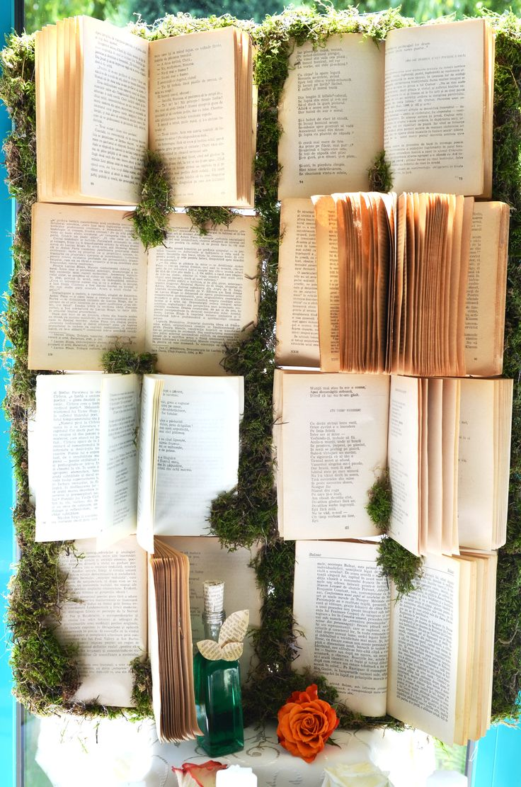Candy bar backdrop made of vintage books and moss