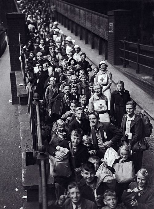 Lines of children await evacuation from London. Paddington Station, The Blitz.