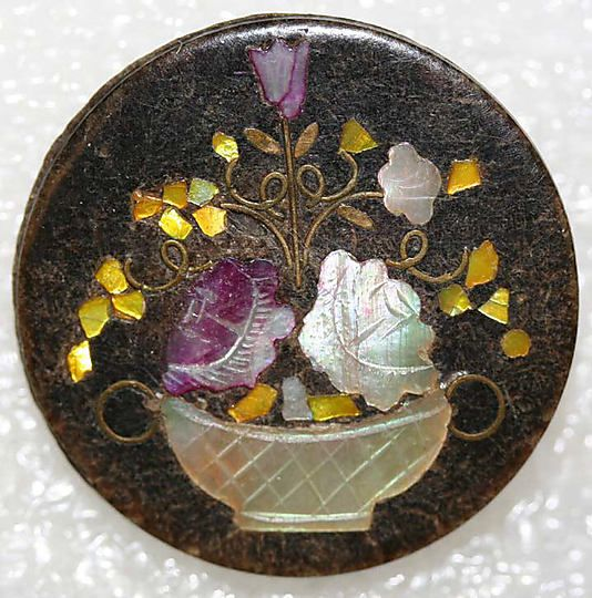 Great british horn button with inlay of mother of pearl Date ca. 1880 Medium : horn, mother-of-pearl, paper, metal From the Hanna S. Kohn Collection, 1951