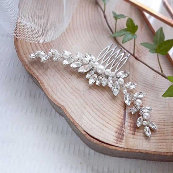 Check out this item in my Etsy shop https://www.etsy.com/listing/514811794/wedding-hair-pearl-comb-hair-accessories
