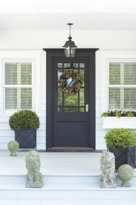 Hanging lantern and dark door. I love the planters with the boxwoods.