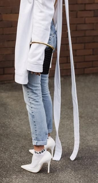 white open back sweatshirt. vintage jeans. pointed heels. socks.