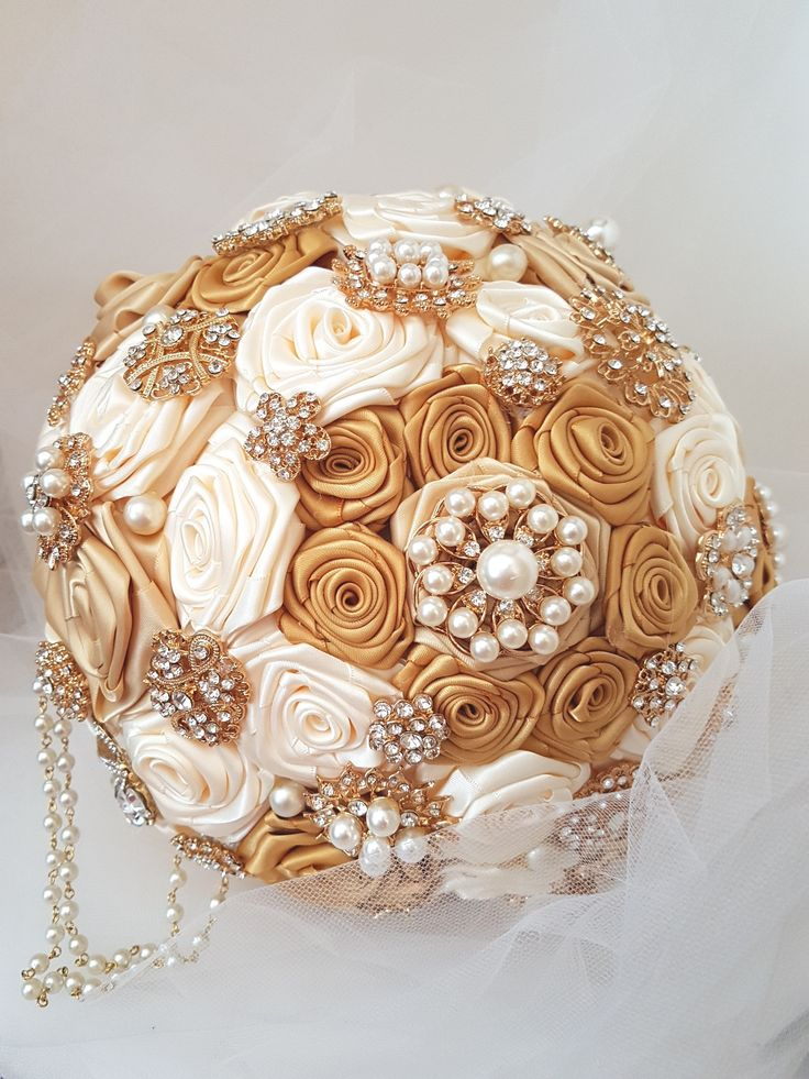 """Gold Bridal Brooch Bouquet, Wedding Bouquet, Fabric Flower Bouquet. Cream, light gold and old gold satin ribbon handmade roses. Gold tone brooches, pearls and cascading pearls accents. 10"""" bouquet."""