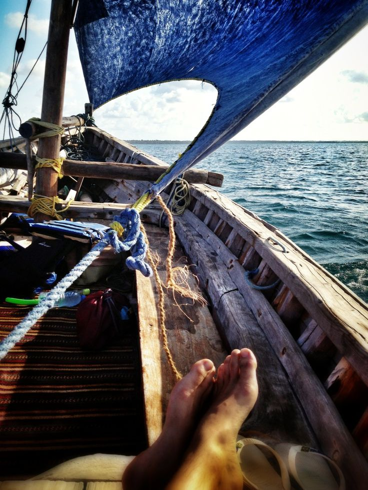 lifestyleoftheunemployed:   Sailing in a dhow at sunset after snorkeling off Mafia island, Tanzania. Lifestyle of the Unemployed