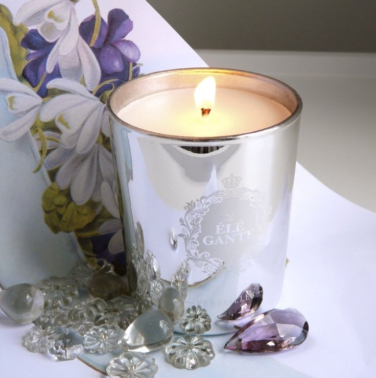 The L'Elegante candle by Elisabeth de Feydeau. The femininity of an elegant woman. The powdery tones of rustling taffeta, dainty satin slippers, porcelain skin flushed with rouge, sweet delicacies, and secrets whispered in a pearly boudoir. An absolutely divine violet and mimosa sillage. Pinkberry, Leaf of Raspberry Bush, Violet, and Musk. Made in France. #lilycharleston #elisabethdefeydeau #artyfragrance #candle #luxury #paris #french #shopcharleston #charleston