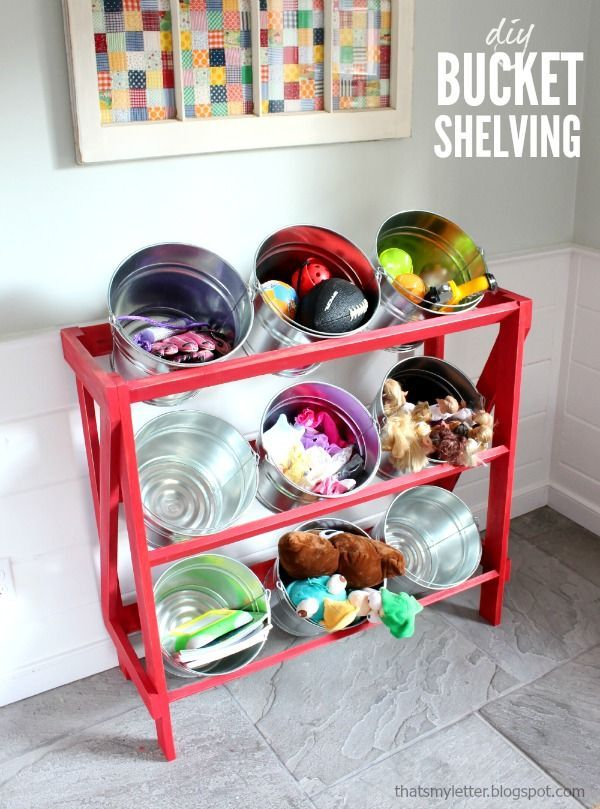 DIY bucket shelving. Free plans to build open shelves to hold buckets for storage.