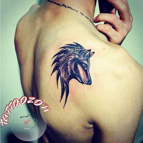tattoozon - trabzon dövme - sırt çizgisel gölgeli kurt dövmesi - dorsal back tribal wolf tattoo