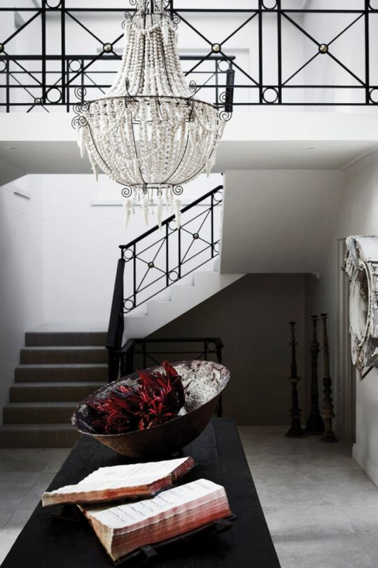 House Tour A Lesson In Layering By Interior Designer Pamela Makin Shell Chandelier Anchors The Space Around Stairwell