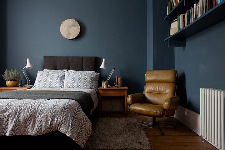 The master bedroom is painted a dark grey (Steel Symphony from Dulux). The bedside lamps are Anglepoise and the mustard leather reclining chair is a vintage Guy Rogers.