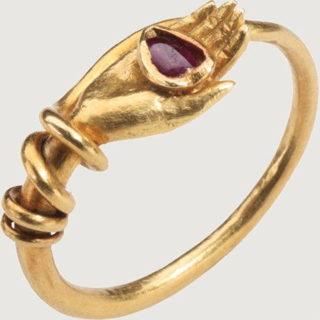 "REVIVALIST RING WITH HAND HOLFING A HEART. Italy, Rome, signed Castellani, c. 1860–1870. Gold and ruby. In the nineteenth century, archaeological finds, especially in Rome, led to a greater interest in Antiquity and the revival of ancient styles. Ultimately the jewelry of the ancient Etruscans and Romans were the inspiration for ""archaeological-style"" jewelry, which was highly fashionable from about the 1860s to 1880s."