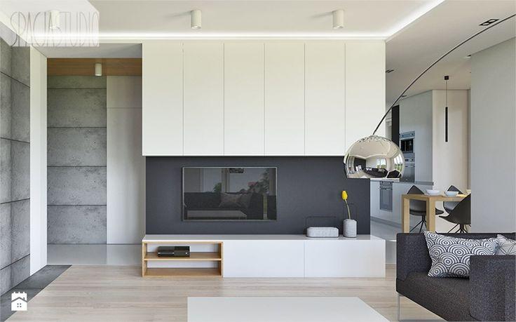 dom w Toruniu - Średni salon z kuchnią z jadalnią, styl minimalistyczny - zdjęcie od Spacja Studio