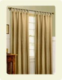 Window drapes generally hang to touch room floors, are sewn with heavier fabric that block more light and give more privacy when closed. They are often lined and attached by hooks to a drapery rod, with a cord behind either drapery panel to draw both drapes open or closed. Window drapes are also pleated and offer a much fuller, richer look, and take up more space when drawn open
