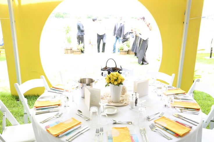 Love the fresh yellow and white of the table settings and decor at Polo in the City