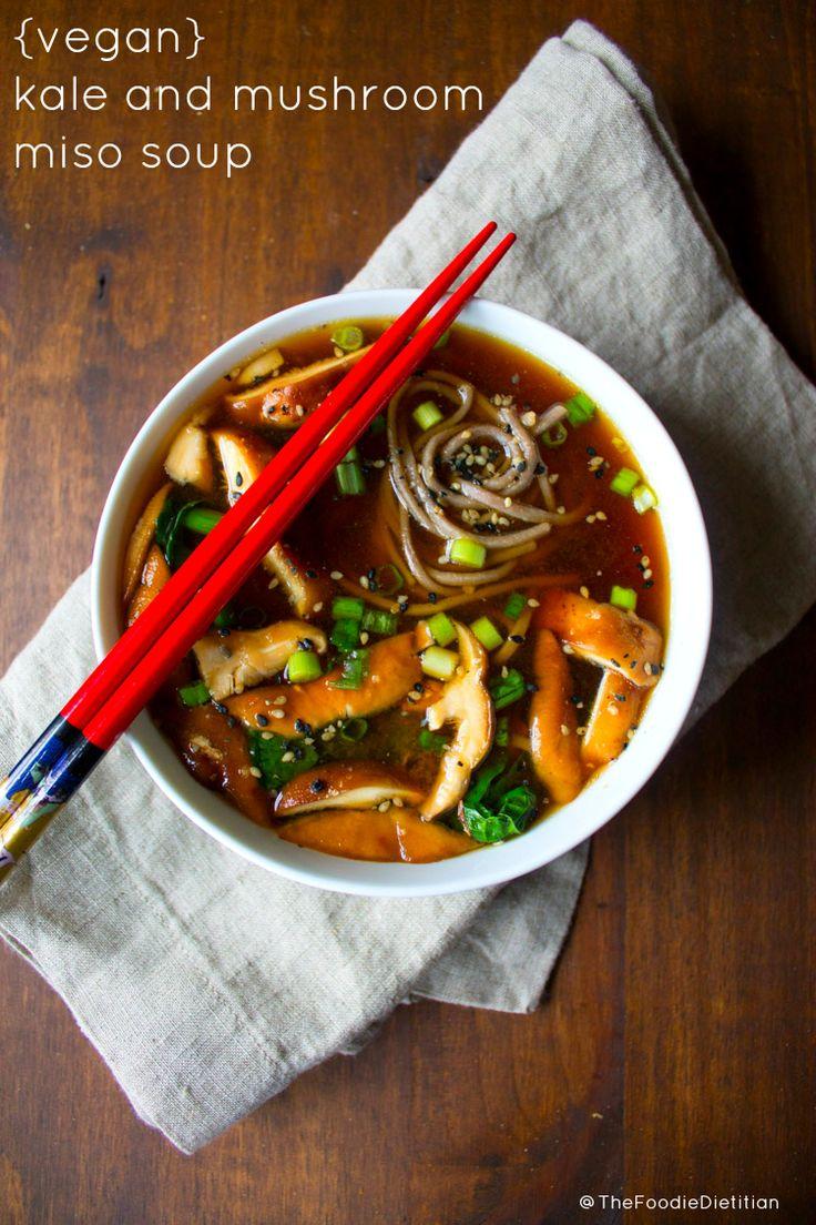 Packed with immune-boosting functional foods like miso, ginger, and mushrooms, this vegan kale and mushroom miso soup is one not to miss during the winter months. | @TheFoodieDietitian