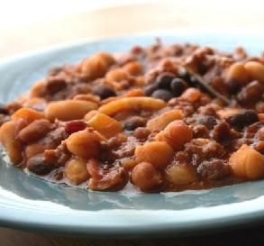 "Crock-Pot Baked Beans Bonanza: ""Fantastic!! I took it into work for a potluck — it was a hit. They couldn't get enough of it cooked this way. Sweet and spicy all rolled into one."" -rebecca mcgill"