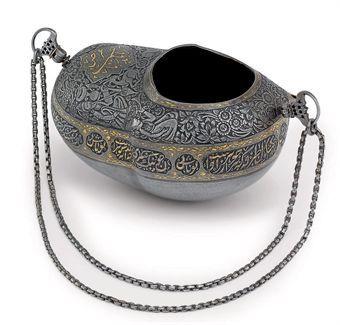 A GOLD-DAMASCENED AND ENGRAVED STEEL KASHKUL BY [HAJJI] 'ABBAS, QAJAR IRAN, DATED AH 1271/1854-55 AD