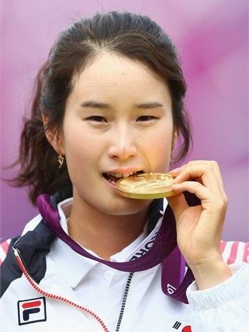 Ki Bo Bae of Republic of Korea celebrates with her gold medal