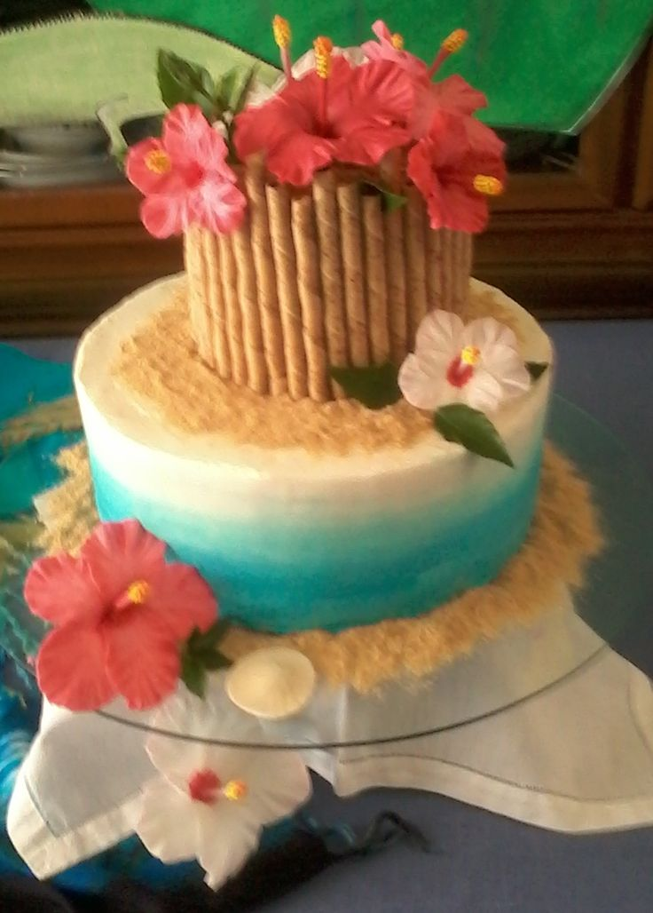 Luau cake. Fondant Hibiscus flowers. Pepperidge Farms cookie bamboo. Crushed graham cracker sand. I made this for a friend.