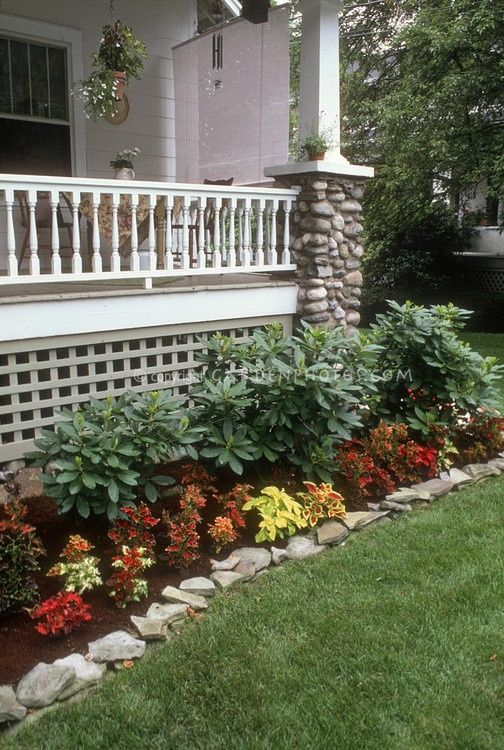 landscaping in front of a porch