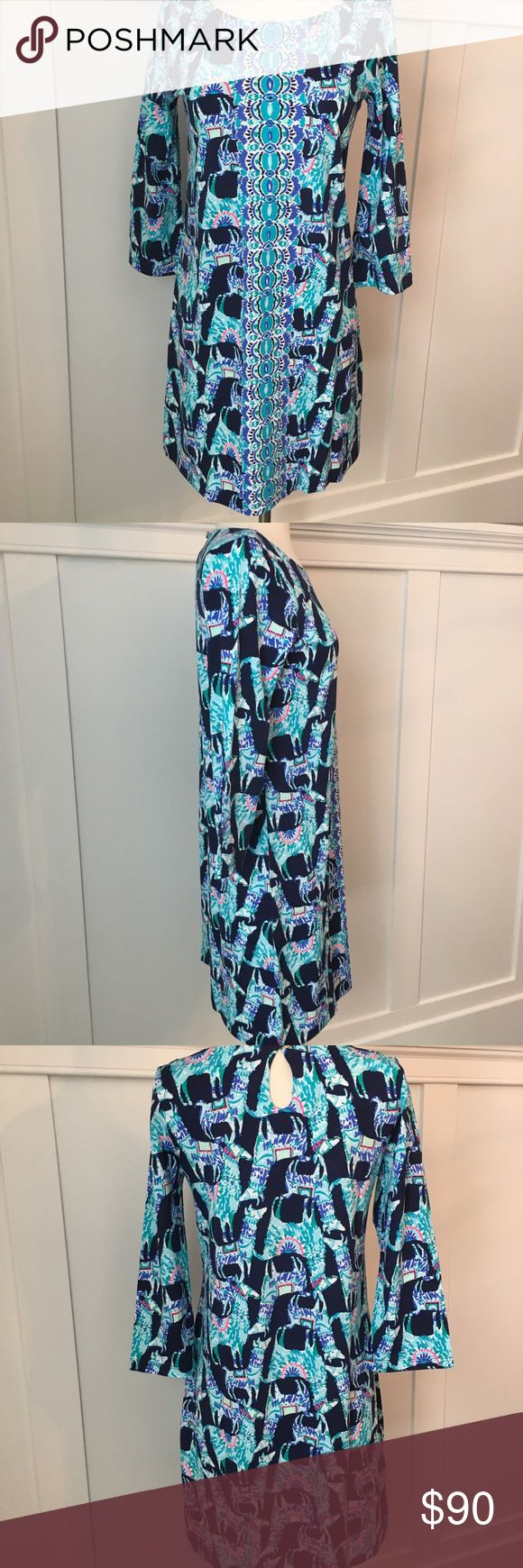 NWT Lilly Pulitzer Bright Navy Bay Dress New With Tags Lilly Pulitzer Bright Navy Bay Dress.  Size Small.  A casually stylish knit dress that can be worn with sandals, sneakers, or heels depending on the occasion. Three-quarter sleeve dress in a printed pima cotton jersey. Straight fit. Boat neckline. Back keyhole and button-and-loop closure at the nape. Straight hem. Unlined. 100% pima cotton. Machine wash, tumble dry. Made in Peru.  Length: 36 in Lilly Pulitzer Dresses