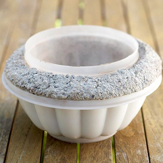 Use pairs of slightly different-size containers to shape your pots. Before the concrete sets, poke a drainage hole with a cork.