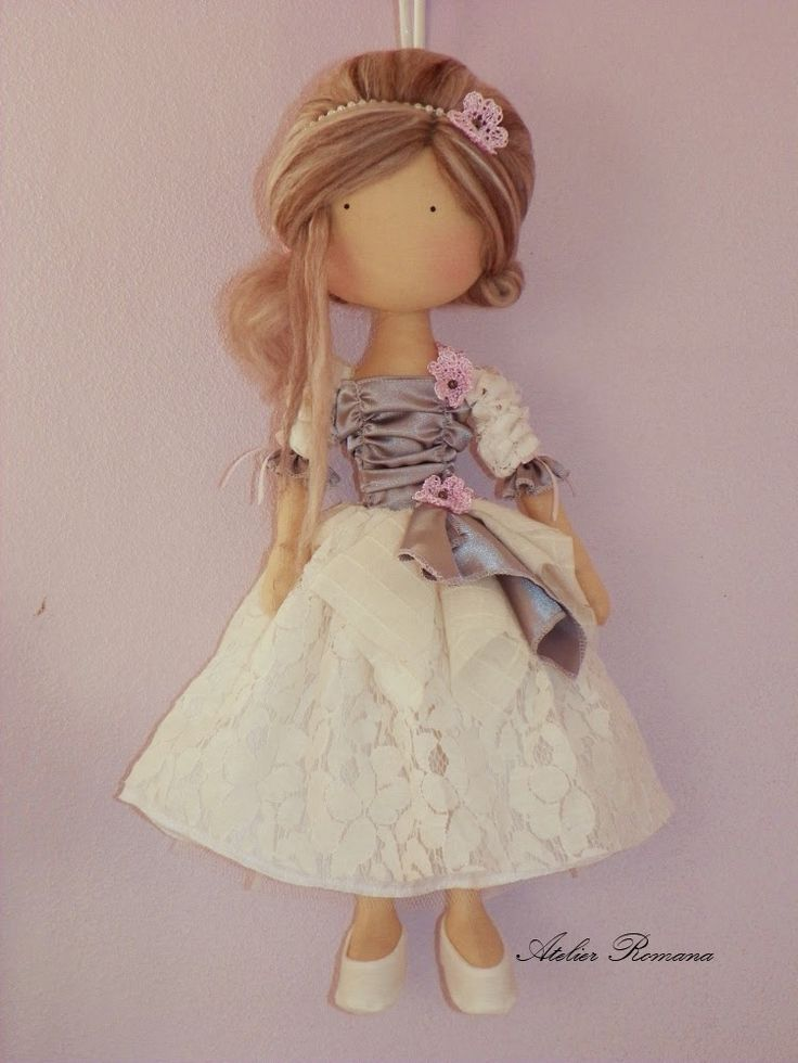 such a charming doll!....i can see her in angel's wings, too....