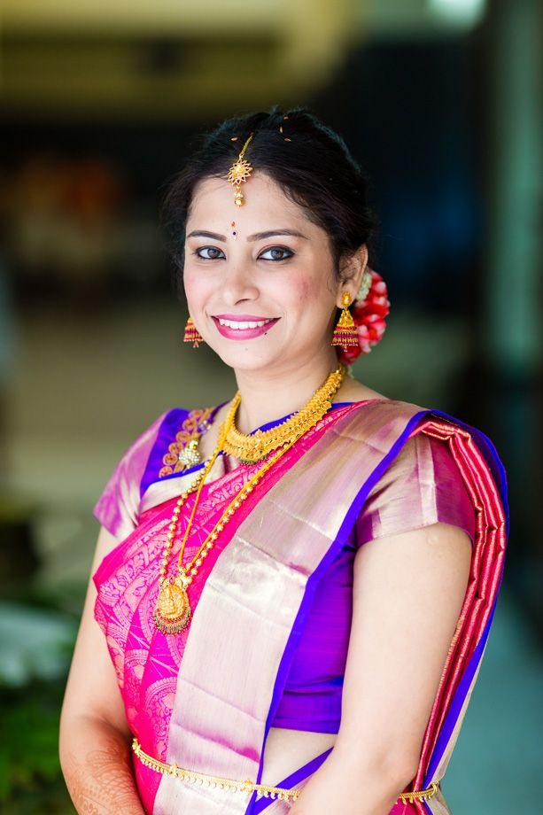 South Indian bride. Pink Kanchipuram silk sari. Temple jewelry. Braid with fresh flowers. Tamil bride. Telugu bride. Kannada bride. Hindu bride.Malayalee bride.