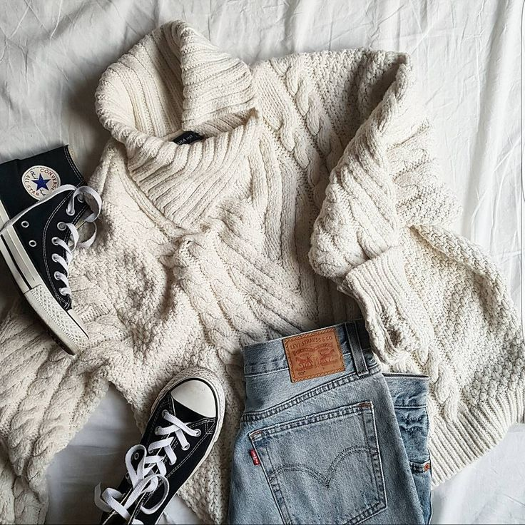 Classic and cozy. Pair your favorite denim with a chunky knit, ivory sweater and classic black Chuck Taylor All Star sneakers by Converse for an easy Sunday look. Photo by blogger Ina Zagreb of Sense for Style.