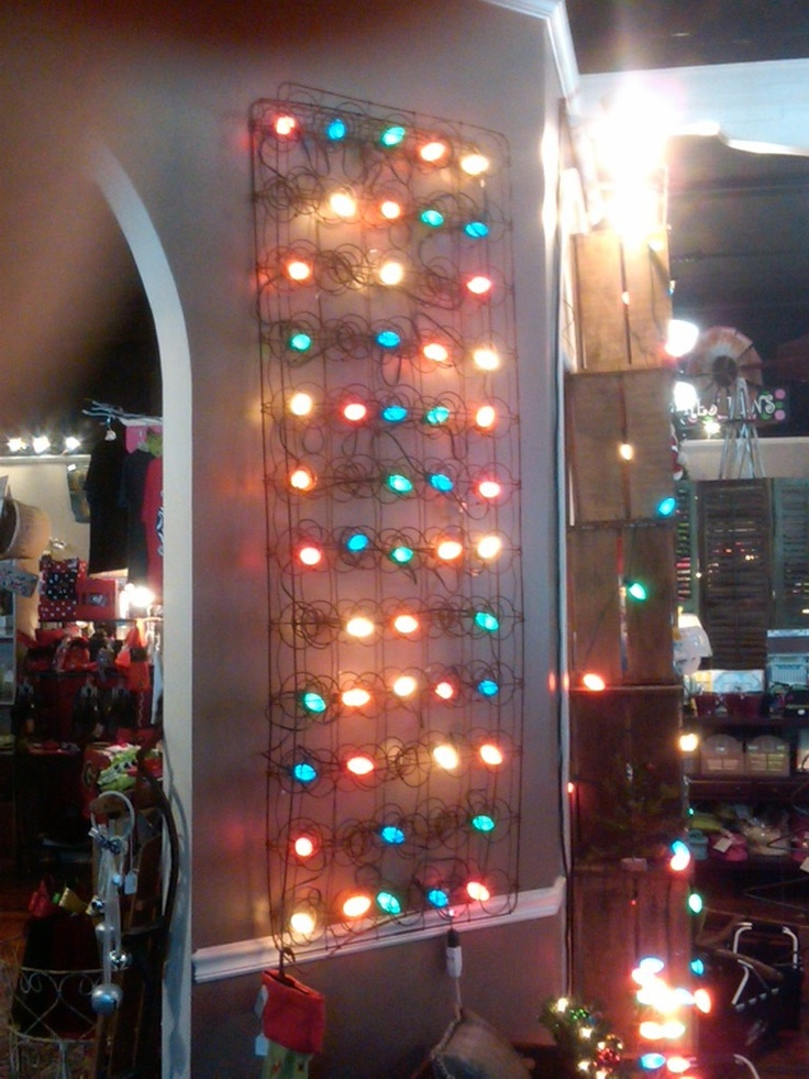 Old mattress springs with lights strung through. Hang vertically on wall or horizontally from ceiling.