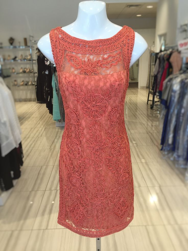 Stunning coral gown with a very unique design!